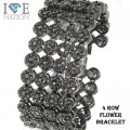 Flower 4 Row Bracelets with simiulated stones is appx 8.25 inches with very nice and shiny stones appx 504 Stones